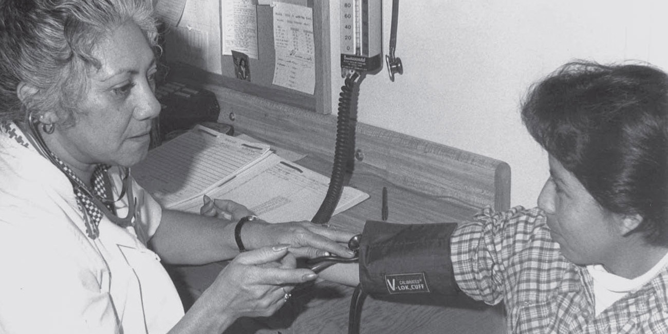 health care worker treating patient at La Clinica, California